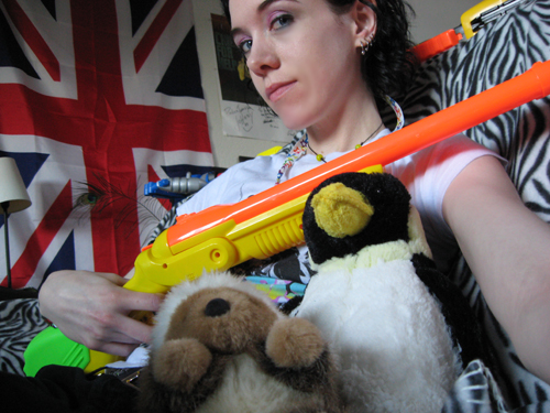 Amber with nerf gun and stuffed hunting companions