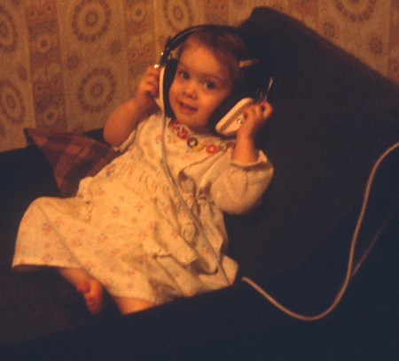 Toddler Amber listening to old headphones