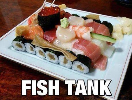sushi arranged to look like a military tank. punny text: fish tank
