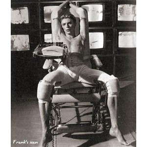 Bowie from The Man Who Fell to Earth, in the torture chair
