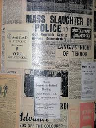 News clippings from the District 6 Museum with non-fiction stories of inhumanity