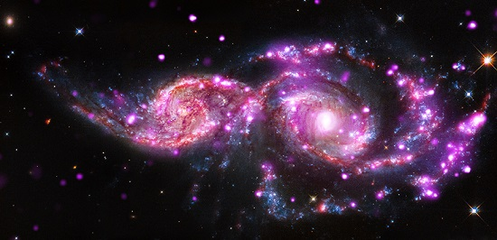 picture of space (Two galaxies: NGC 2207 and IC 2163)