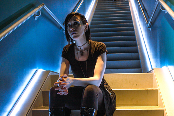 Amber, sitting on stairs, landscape orientation, in colour